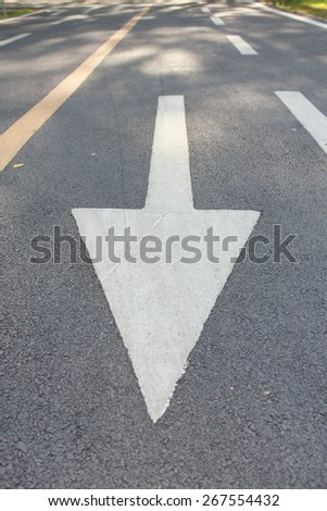 The arrow directions on the road. - stock photo