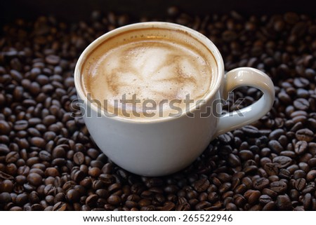 The art of cappuccino or latte on white coffee cup.  - stock photo