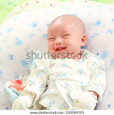 Asian baby having fun