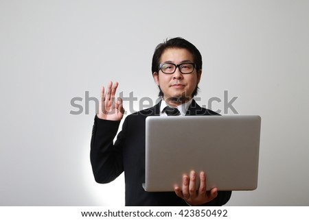 The Asian businessman with laptop. - stock photo
