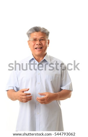 The Asian elder man on the white background.