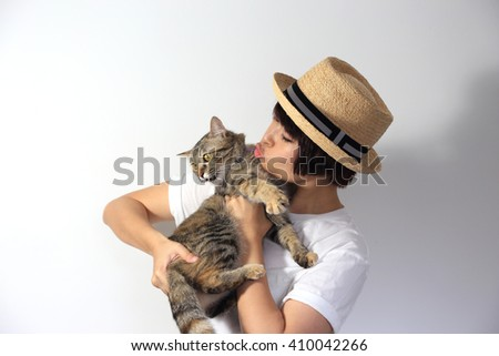 The asian woman holding tabby cat. - stock photo