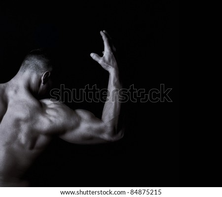 The athlete shows his beautiful body - stock photo