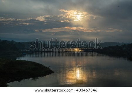 The atmosphere, the morning, clouds and beautiful light golden, Mon bridge,Sangkhlaburi. Kanchanaburi