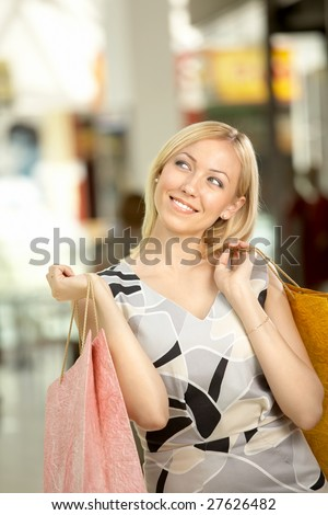 The attractive woman in shop has control over purchases - stock photo