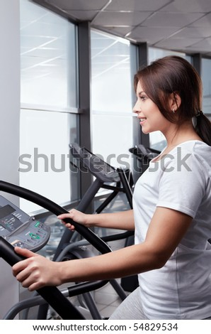 The attractive young girl goes in for sports - stock photo