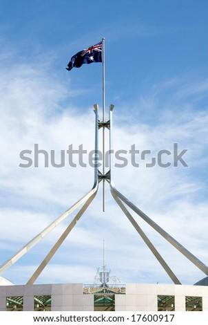 The Australian flag, atop Parliament House, Canberra, Australia - stock photo