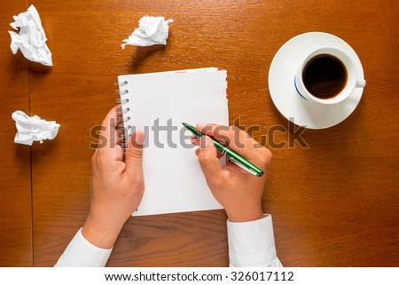 the author writes in a notebook your thoughts in the frame hands only