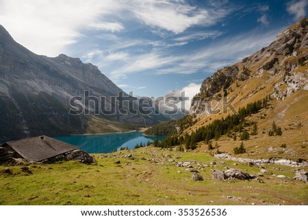 The autumn view over the Oeschinensee mountain lake in Swiss Alps