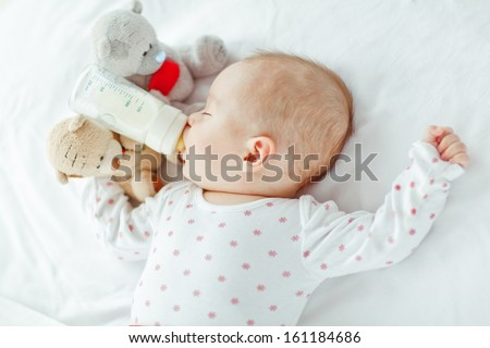 The baby eats - stock photo