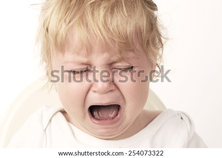 The baby girl eating and crying with white background  - stock photo