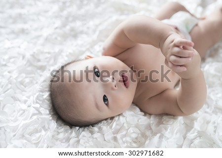 The baby in bed to play - stock photo