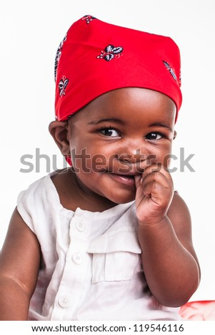 The baby is dressed like a little gangster. - stock photo