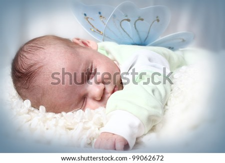 The baby sleeps on a light background