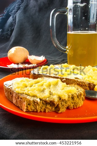 the bachelor dinner - toast with butter and yellow caviar, boiled eggs and unfiltered beer