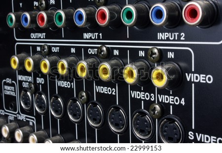 The back connection panel of a home cinema set - stock photo