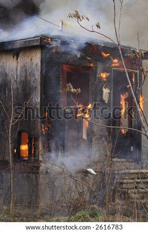 The back of an urban house destroyed by fire - stock photo