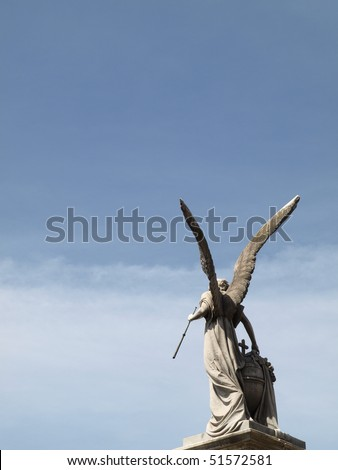 The back of angel with wings under blue sky from Recoleta Cemetery Argentina - stock photo