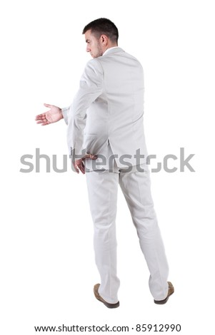 The back of businessman extending hand to shake. Rear view. Isolated over white background.