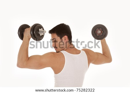 The back view of a man that is lifting some weights. - stock photo