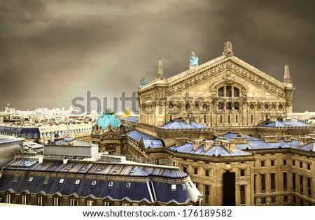 The back view of the Opera house in Paris with a dramatic sky background - stock photo