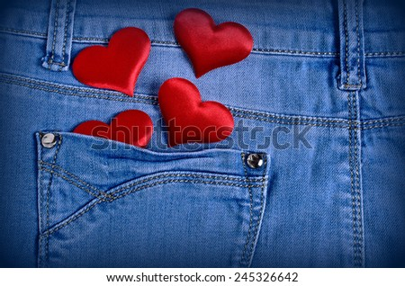 The background for Valentine's Day. Abstraction of denim and hearts of the fabric. - stock photo