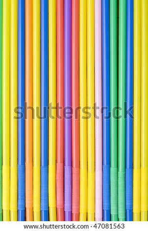 The background of colorful straws for cocktails