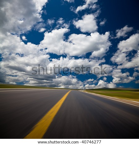 the background of the road wiht cloud of a meadow china. - stock photo