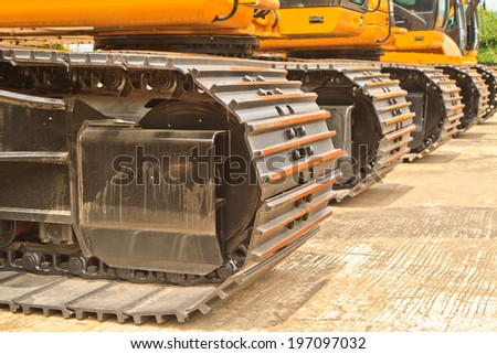 The backhoe loader on  a concrete floor - stock photo