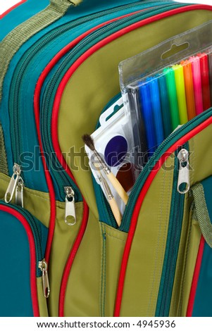 The backpack of the schoolboy filled with a stationary - stock photo