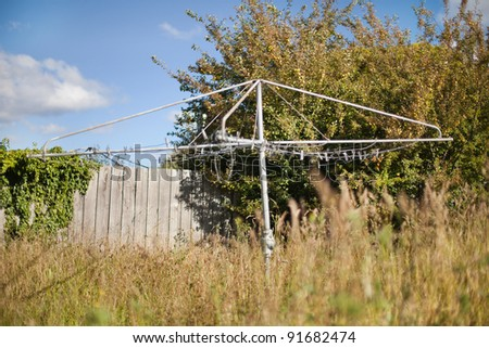 The backyard clothesline is an Australian icon, seen here in an overgrown backyard
