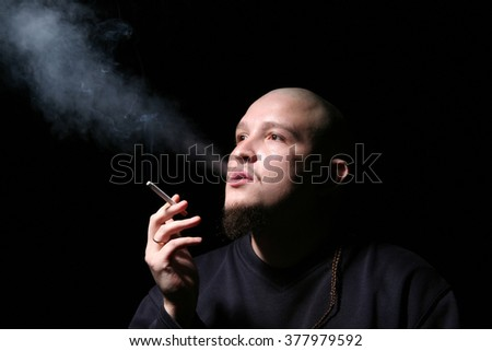 The bald man with a cigarette