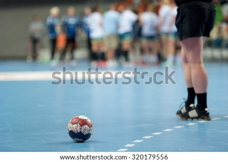 The ball on the court during a break of the handball match - stock photo