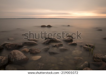 The baltic sea photographed daytime with long exposure - stock photo