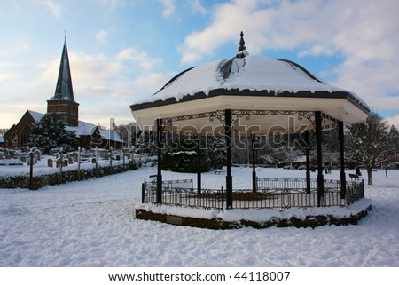 The bandstand and church in Godalming, Surrey taken from the park during the big freeze of January 2010 - stock photo