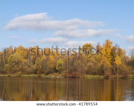 The bank of the river is in autumn