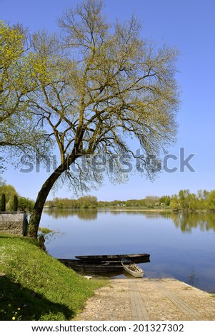 The banks of the Vienne river at Candes-Saint-Martin with trees, commune in the Indre-et-Loire department , Centre region in France.