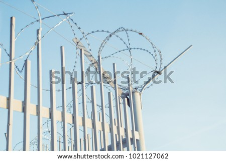 Barbed Wire Wound On Top Fence Stock Photo & Image (Royalty-Free ...