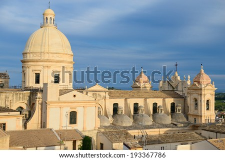 The baroque cathedral of Noto, in Sicily, seen at sunset from a privileged point of view. Noto has been declared UNESCO site in 2002. - stock photo