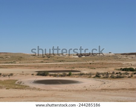 The barren golf courses of Coober Pedy in Australia - stock photo