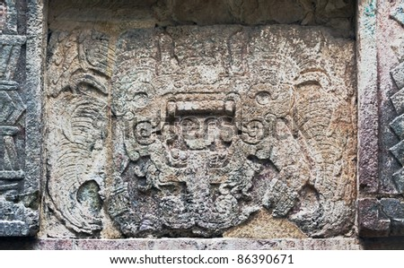 The bas-relief on the wall of the palace in Chichen Itza, Mexico