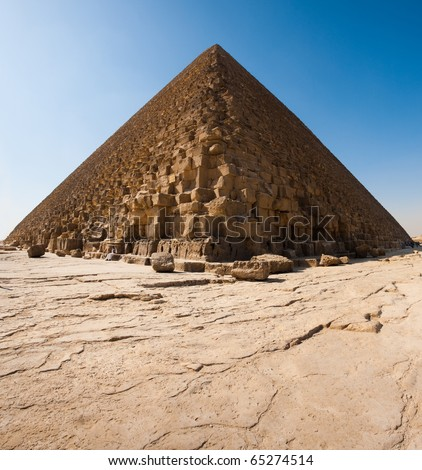 The base of the Great Pyramid of Cheops (Khufu) is seen on its solid rock foundation - stock photo