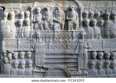 The base of the Obelisk of Thutmosis III showing Emperor Theodosius as he offers a laurel wreath to the victor from the Kathisma at the Hippodrome, Istanbul, Turkey