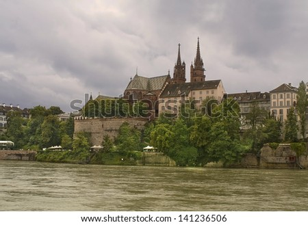 The Basel Cathedral (Minster), one of the main landmarks and tourist attractions of the city on a rainy day - stock photo
