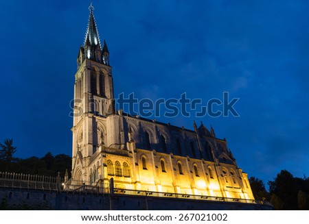 The Basilica of Our Lady of the Immaculate Conception in Lourdes at night - stock photo
