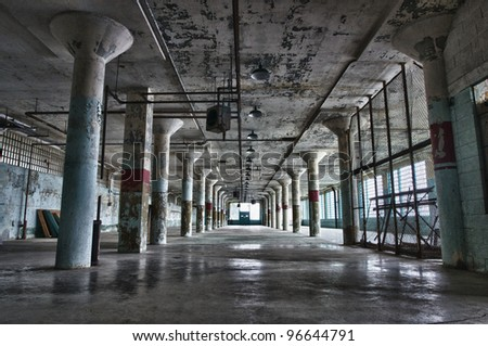 The battered, rusted remains of the work house on Alcatraz island. - stock photo