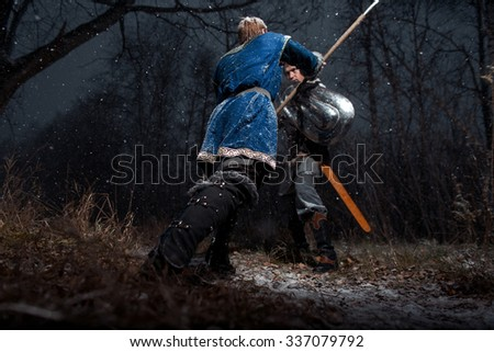 The battle between medieval knights in the style of Game of Thrones in winter forest landscapes. Spear against sword