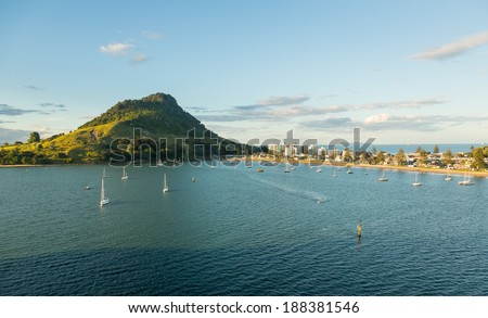 The bay and harbour at Tauranga with calm water in front of the Mount - stock photo