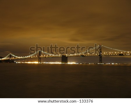 The bay bridge and east bay city lights, in San Francisco at night.