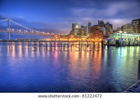 The Bay Bridge and the Embarcadero from the Ferry Plaza, San Francisco - stock photo